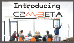 Image of C2M beta office and team working on solutions for the cohort company